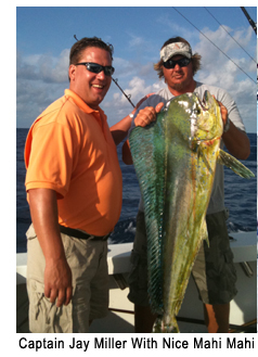 Captain Jay Miller with angler and large mahi mahi